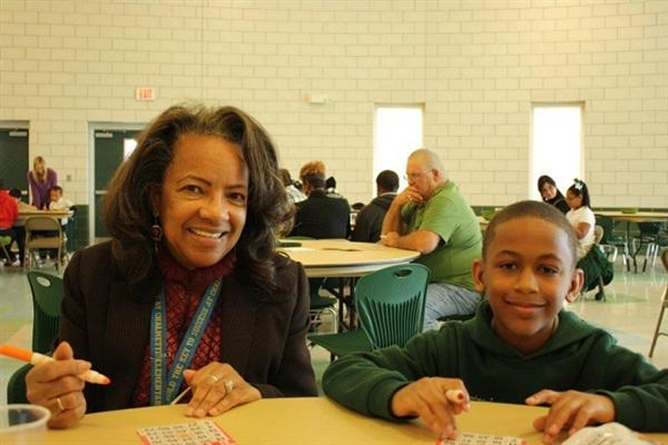 Employee Feature Ms. Ben with a student